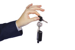 Keys to the car. Woman's hand with keys and key chains from the car Royalty Free Stock Photos