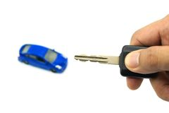 Right hand holding car key and car model for business concept stock images