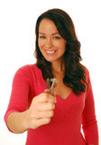 Keys to the door. Excited woman holding keys isolated on white (focus on face Royalty Free Stock Photography