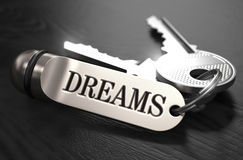 Keys to Dreams. Concept on Golden Keychain. Keys to Dreams - Concept on Golden Keychain over Black Wooden Background. Closeup View, Selective Focus, 3D Render Stock Photography
