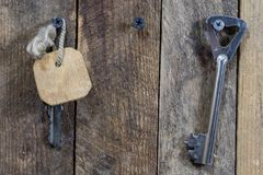 Keys to the front door of the house. Various accessories needed stock photography