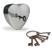 Keys to the heart. Key unlocking a metal heart Stock Photos