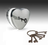 Keys to the heart. Key unlocking a metal heart Royalty Free Stock Photography