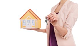 Keys to the house. Keys to the house are in the hands of a realtor. Advantageous offer Stock Photos