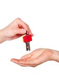 Keys to New Home. House keys being handed to a new homeowner Stock Image