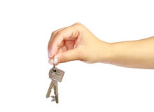 Keys to new home. Woman's hand holding keys to new house Stock Photography