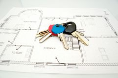 Keys to new home. Keys to new house - construction plans Stock Photos