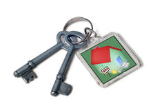 Keys to New House. Two keys on keyring containing drawing of house with sold sign Royalty Free Stock Photos