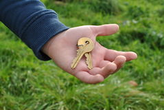 Keys to new house. Hand holding keys to new house royalty free stock image