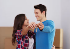 Keys to our new home. Young couple holding key to new home in hand Stock Photo
