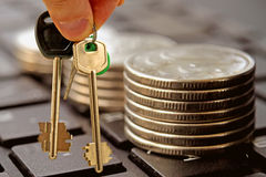 The keys to a private house on a background of money Royalty Free Stock Image