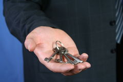 KEYS TO SUCCESS. Businessman offering keys Royalty Free Stock Photo