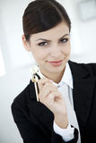 Keys to success. Businesswoman holding the key to success Stock Images
