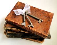 Keys to Success. A stack of antique books with vintage keys on top of them. This concept represents the fact that knowledge/reading/education, etc. are the keys royalty free stock images
