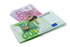 Keys on a top of bank notes Stock Photo