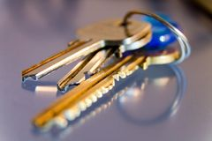 Keys with trinkets, close-up, keys to home stock image