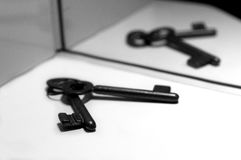 Keys. Two Old keys in front of a mirror Royalty Free Stock Photo