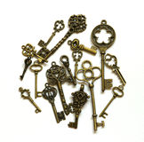 Keys. Vintage bronze keys on the white space Stock Photography