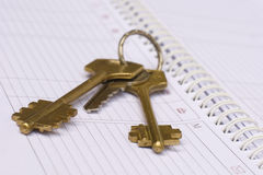 Keys and weekly journal Royalty Free Stock Photo