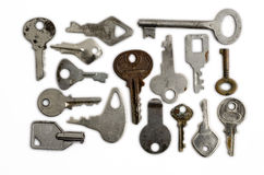 Keys on a White Background. Several keys, ancient and modern, over white background Stock Photography