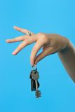 Keys in woman hand. Beautiful womans hand demonstrating the bunch of keys royalty free stock images