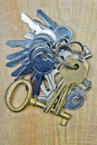 Keys on wooden background. Silver keys on wooden background Stock Image