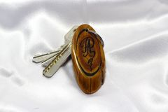 Keys with wooden handmade keychain Stock Images