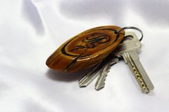 Keys with wooden handmade keychain Royalty Free Stock Photo
