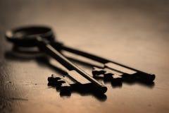 Keys on Wooden Surface to Unlock Stock Photography