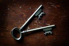 Keys on Wooden Surface to Unlock Stock Photos
