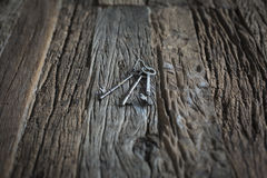 Keys on a wooden table. Old keys left on a old wooden table made out of old barn wood Royalty Free Stock Photography