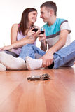 Keys and young couple on the floor stock photos