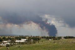 Keystone Wildfire burning in Wyoming. Smoke and clouds from Wyoming`s Keystone wildfire Stock Photo