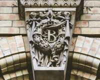 Keystone with Wreath and letter B. Split Toning Shallow Depth of Field stock photo