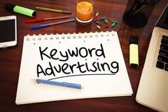 Keyword Advertising. Handwritten text in a notebook on a desk - 3d render illustration royalty free illustration