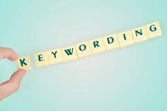 Keywording word. On blue background stock photo