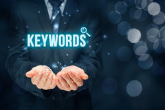 Keywords. Find keywords - SEO and SEM concept. Marketing specialist offer keywording services Stock Photos