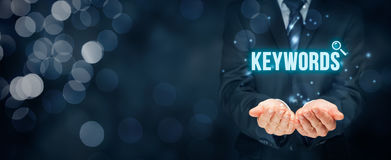 Keywords. Find keywords - SEO and SEM concept. Marketing specialist offer keywording services Royalty Free Stock Images