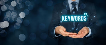 Keywords. Find keywords - SEO and SEM concept. Marketing specialist offer keywording services Royalty Free Stock Photos