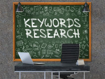 Keywords Research Concept. Doodle Icons on Chalkboard. 3D Render. Royalty Free Stock Photography