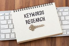 Keywords research with key on computer keyboard. Keywords research for seo concept with key and computer keyboard Stock Photos
