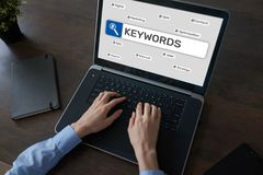 Keywords. SEO, Search engine optimization and internet marketing concept on screen. Keywords. SEO, Search engine optimization and internet marketing concept on stock photo