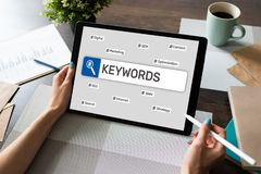 Keywords. SEO, Search engine optimization and internet marketing concept on screen. Keywords. SEO, Search engine optimization and internet marketing concept on stock photography