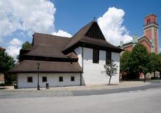 Kezmarok, Slovakia. Historic wooden church and modern church in town Kezmarok, northern Slovakia royalty free stock photography