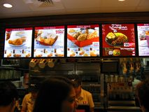 KFC Menu Board at a KFC Restaurant in an Indoor Shopping Mall. KFC Kentucky Fried Chicken menu board, which features the new Spicy Gangnan Chicken Korean Style stock images