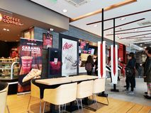 KFC restaurant indoor, Romania - people making choices on billboards. Kentucky Fried Chicken is a chain of american restaurants owned by Yum! Brands, Inc royalty free stock images