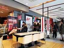 KFC restaurant indoor, Romania - people making choices on billboards. Kentucky Fried Chicken is a chain of american restaurants owned by Yum! Brands, Inc royalty free stock photo