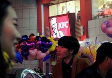 KFC shop in China, balloons and Chinese faces Royalty Free Stock Images