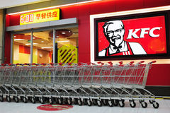 KFC and shopping trolley. The KFC restaurant and shopping trolley in the supermarket Royalty Free Stock Photo