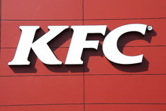 KFC sign. KFC (Kentucky Fried Chicken) sign on red wall background Royalty Free Stock Photos